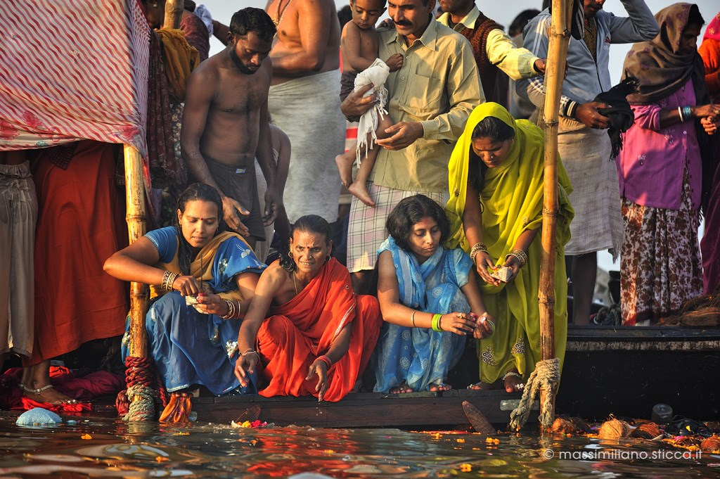 Indian women releases an offering to Ganges at the Kumbh Mela.